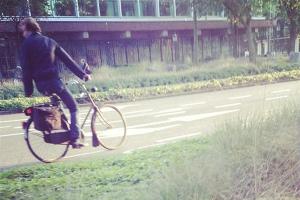 A cyclist passes Nederlandse Bank, Frederiksplein