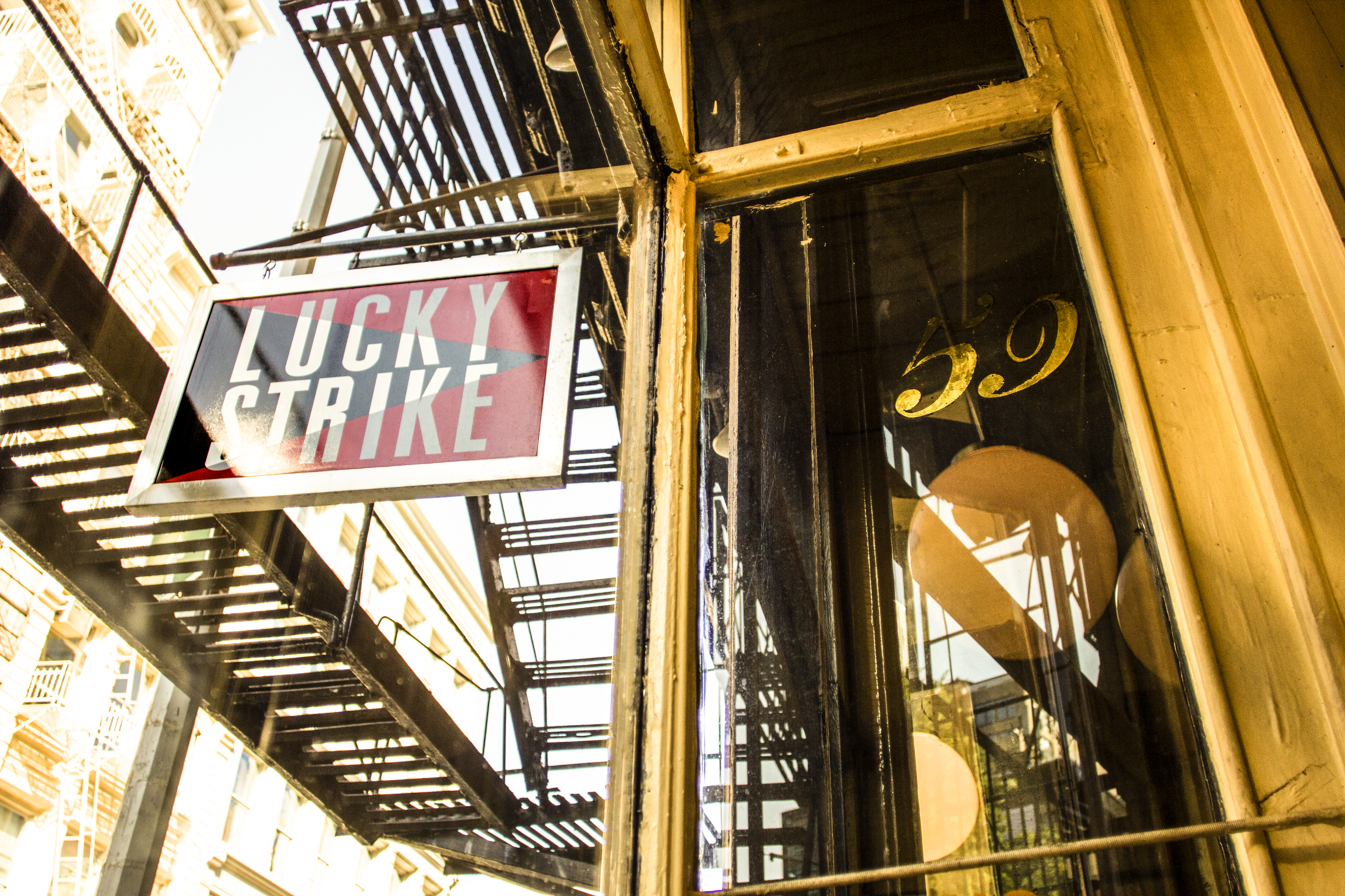 The entrance and sign to a bar called Lucky Strike in SoHo, Manhattan